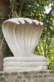 Shrine with large, white five-headed cobra statue of Shesha. — Stock Photo