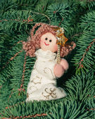 Christmas toy angel on the Christmas tree — Stock Photo
