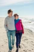 Young couple walking near the sea — Stock Photo