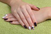 Beauty treatment of fingernails, hands on towel — Stock Photo