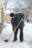 Winter time, snow removing — Stock Photo