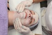 Beauty treatment of young female face — Stock Photo