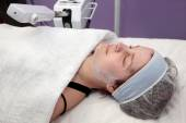 Beauty treatment of young female face, ozone facial steamer — Stock Photo