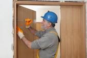 Worker install new door — Stock Photo