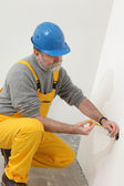Electrician at construction site testing installation — Stock Photo