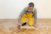 Home renovation, oak parquet varnishing finish — Stock Photo