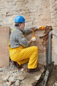 Plumber at construction site installing sewerage tube — Stock Photo
