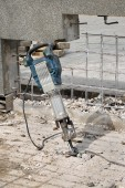 Construction site, demolishing with electric plugger — Stock Photo