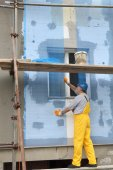 Styrofoam facade insulation, installing mesh — Stock Photo