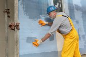 Styrofoam facade insulation, installing mesh — Stock Photo