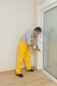 Home renovation, caulking with silicone — Stock Photo