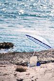 The stony beach with parasol — ストック写真