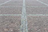 Square cobbled with granite stones — Stock Photo