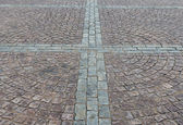Square cobbled with granite stones — Stock Photo