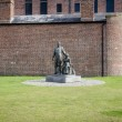 Постер, плакат: The Emigrants statue Albert Dock Liverpool
