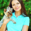 Beautiful girl portrait with puppy yorkshire terrier — Stock Photo #51941571