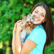 Beautiful smiling girl portrait with puppy yorkshire terrier — Stock Photo #51941707