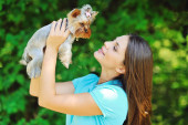 Beautiful girl portrait with puppy yorkshire terrier — Stock Photo