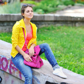 Young casual woman in colorful clothes outdoor portrait  — ストック写真