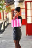 Fashion shopping girl portrait. Beautiful woman with shopping ba — Stock Photo