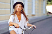 Seductive young woman on a vintage bike — Stock Photo