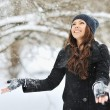 Woman playing with snow in a winter park — Stock Photo #53736605