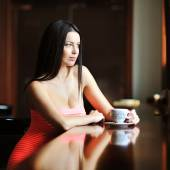 Beautiful lady sitting in the restaurant with a cup of coffee — Stock Photo