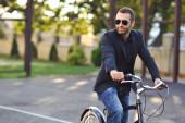 Young stylish man with retro bike — Stock Photo