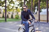 Businessman on his retro bike. Outdoor fashion portrait  — Stock Photo