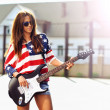Young beautiful girl with electric guitar. Outdoor fashion portr — Stock Photo #54180789