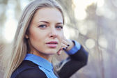 Beautiful woman with long blond hair. Close up portrait of a fas — Stock Photo