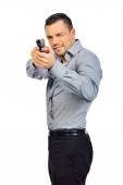 Portrait of young man with gun on white background — Stockfoto