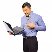 Young man holding laptop with surprised expression isolated on w — Stockfoto
