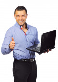 Businessman with laptop computer showing thumbs up. Isolated — Stockfoto