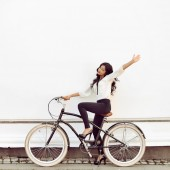 Beautiful happy girl on a vintage bicycle — Stock Photo