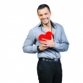 Beautiful handsome young macho man holding love heart and smilin — Stock Photo