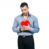 Handsome young macho man holding love heart portrait - isolated — Stock Photo