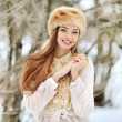 Portrait of smiling young woman in winter outdoors — Stock Photo #56625263