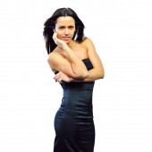 Young brunette lady in black dress posing on white background — Stock Photo