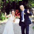Just married couple. Thumb up — Stock Photo #58533081