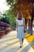 Mysterious lonely girl walking away  — ストック写真