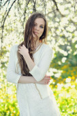 Beautiful young girl in spring park  — Stock Photo