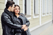 Happy couple in love in an old town — Stock Photo