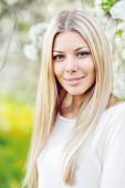 Beautiful young blonde woman face close up — Stock Photo