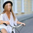 Attractive young woman with bicycle — Stock Photo #64846307