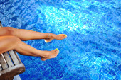 Woman legs in a swimming pool. Vocation & Relax — Stock Photo