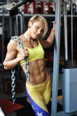 Muscular bodybuilder woman holding chains — Stock Photo