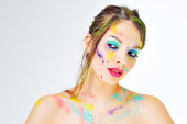 Beautiful girl with colorful paint splashes on face — Stock Photo