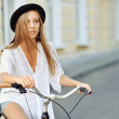 Attractive young woman with bicycle — Stock Photo #72530023