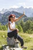 Cute female hiker waving hello — Stok fotoğraf